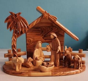 Krippe mit Heiliger Familie, Palme und Tiere aus Olivenholz (ohne Gesichter)