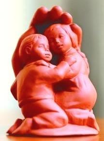 Geschwister - Tonfarbener Steinguss